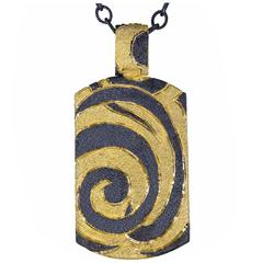 Silver Gold Tag Pendant Necklace with Swirl Pattern by Alex Soldier.