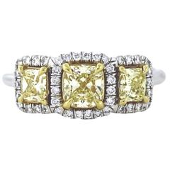 Classic .56 Carat Gia Certified Fancy Yellow Three-Stone Diamond Gold Halo Ring