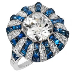 GIA Certified 2.63 Carat Diamond with 4 Carats of Blue Sapphires Platinum Ring