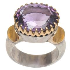 Sterling Silver and 18 Karat Gold Ring with Bezel-Set Faceted Amethyst