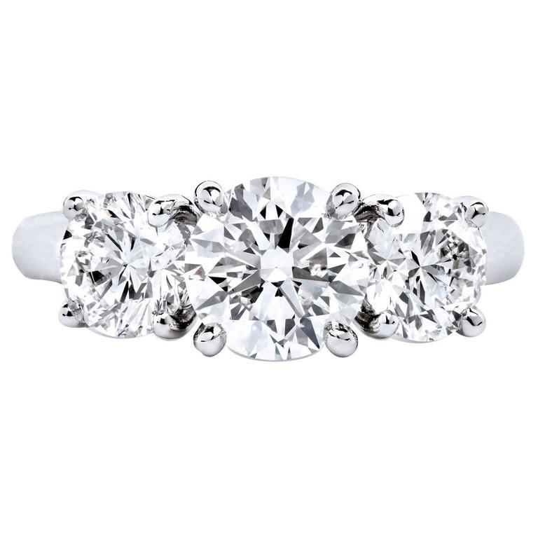 Round Brilliant Cut GIA Cert Diamonds High Polished Platinum Three Stone Ring