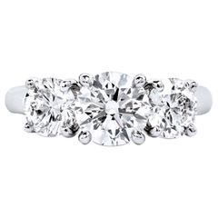 Round Brilliant Cut GIA Cert Diamonds High Polished Platinum Three Stone Ring