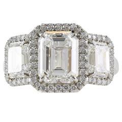 5.14 Carats GIA Cert Emerald Cut Diamonds Platinum Three Stone Ring