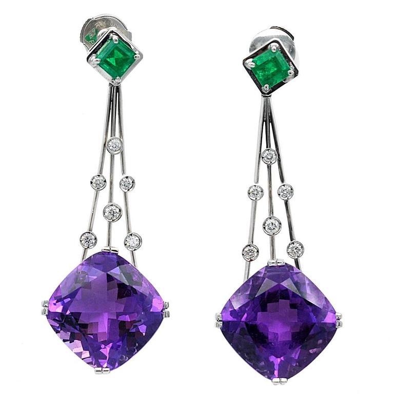 Claris. A Amethyst Emerald Gold Dangle Earrings