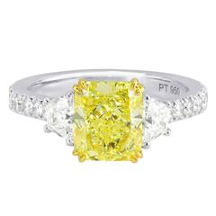 Fancy Intense Yellow Radiant and Trapezoid Diamonds Gold Platinum Ring