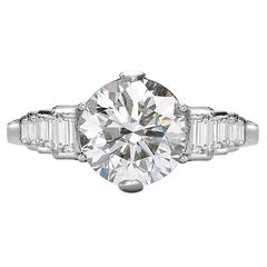 Brilliant Cut Diamond Ring with Baguette Cut Diamond Shoulders