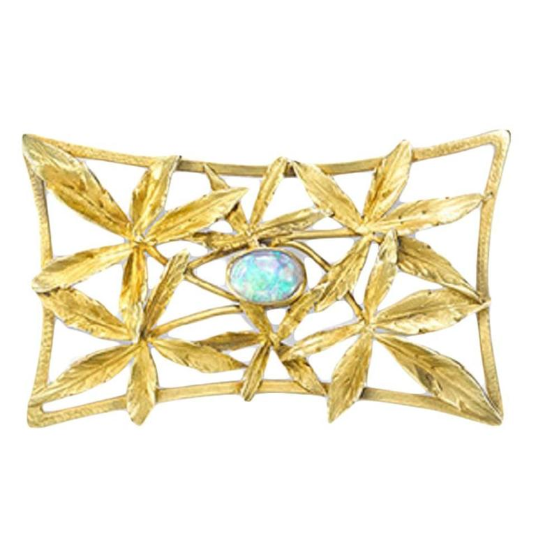 Art Nouveau opal brooch with marijuana leaves