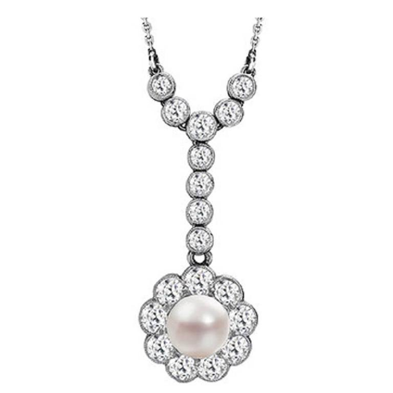 Edwardian pearl and diamond cluster drop pendant