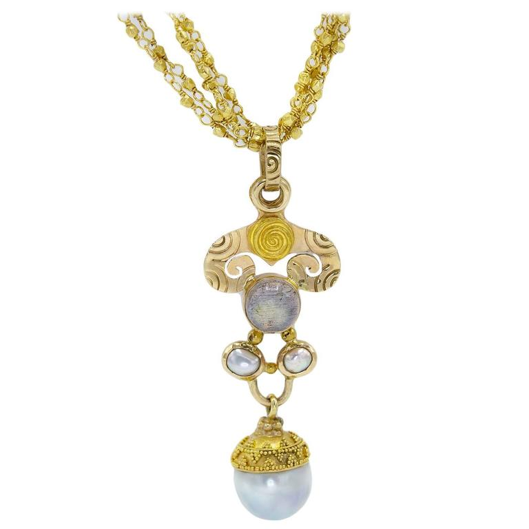 Elegant Spiral Fresh Water Pearl Moonstone Gold Pendant For Sale