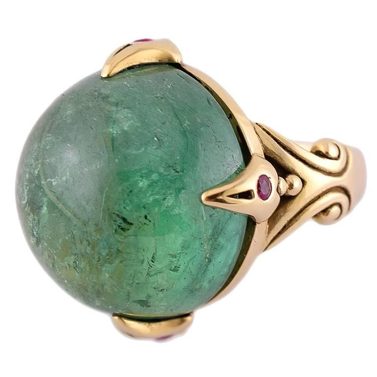 39.50 Carat Round Green Tourmaline Ring with Round Accent Rubies in Gold For Sale