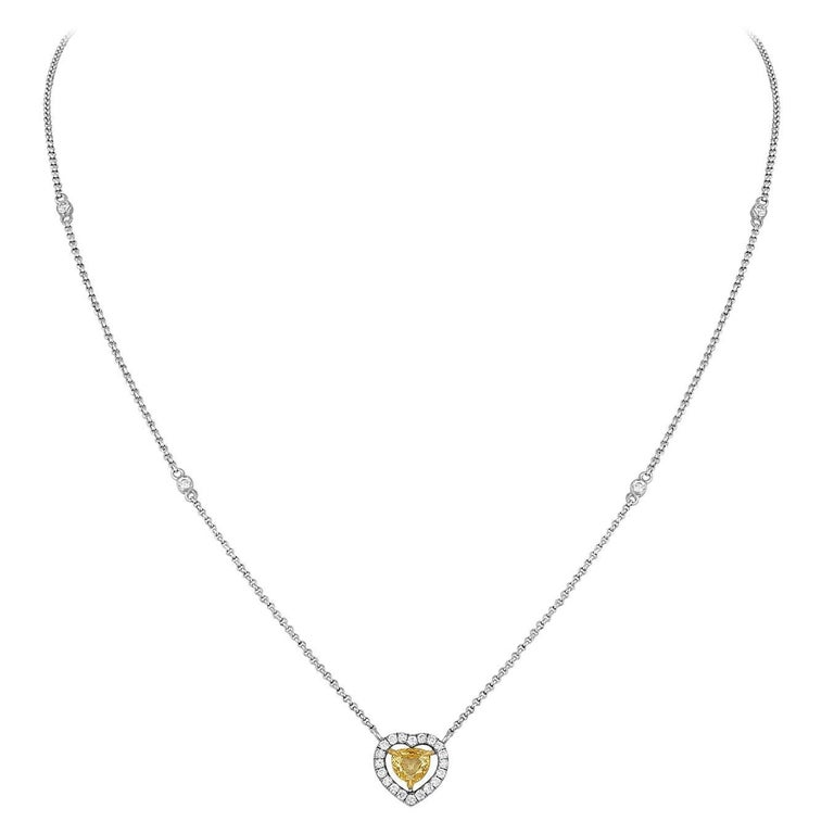 0.48 Carats Fancy Yellow Heart Shape Diamond Halo Necklace For Sale