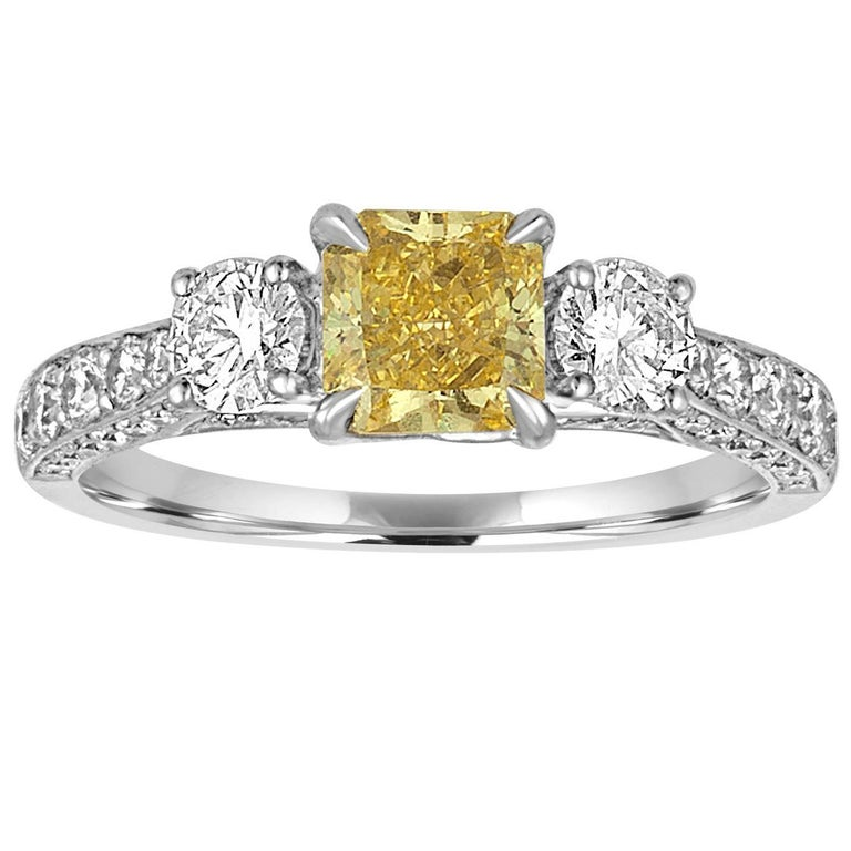 GIA Certified 0.91 Carat Fancy Intense Yellow Diamond Three Stone Gold Ring For Sale