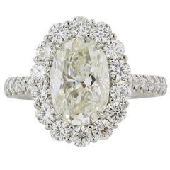 3.00 Carat H/VS1 EGL Certified Oval Diamond Platinum Halo Ring