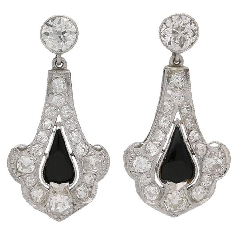 1920s Art Deco onyx and diamond earrings