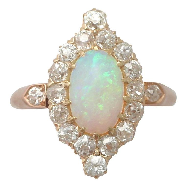 1900s 1.06 Carat Opal and Diamond Rose Gold Cluster Ring