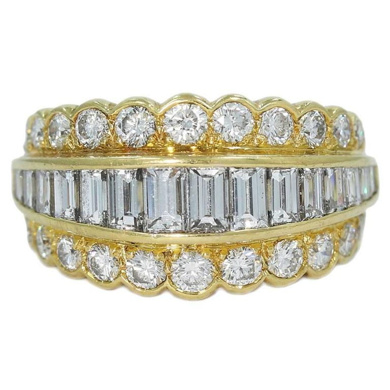 Van Cleef & Arpels Round and Emerald Cut Diamonds Gold Ring