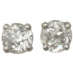Antique and Contemporary 0.57 Carat Diamond and Platinum Stud Earrings