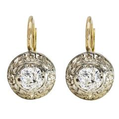 Round Diamond Earrings with a Halo of Engraved White Gold