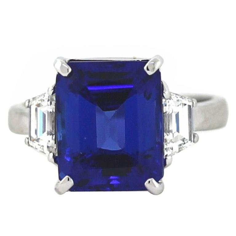 and side stone emerald ring diamond cut gold white tanzanite