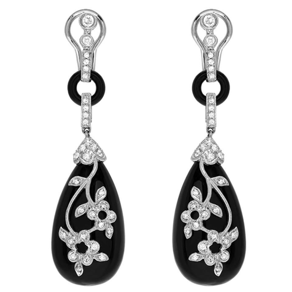 silver platinum white stud plated sapphire earrings and black charmisma