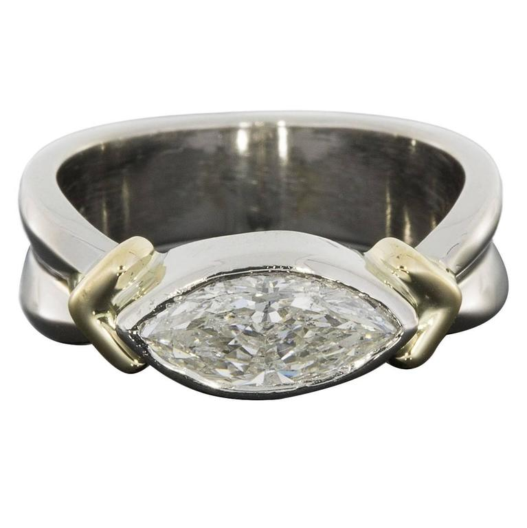 platinum and yellow gold marquise east west bezel