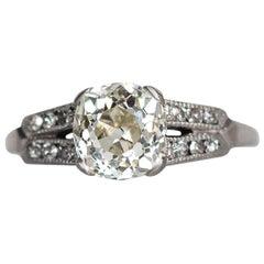 1920s Art Deco Platinum 1.46 Carat Cushion Cut Diamond with Side Stones