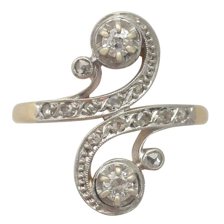 1920s French 0.43 Carat Diamond and Yellow Gold Twist Ring For Sale