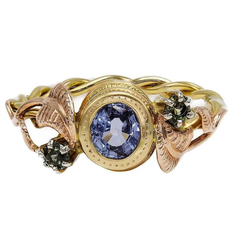 Artisan Sapphire Ring with Rose Gold Leaves and Detailed Bezel For Sale