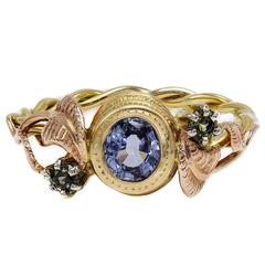 Artisan Sapphire Ring with Rose Gold Leaves and Detailed Bezel