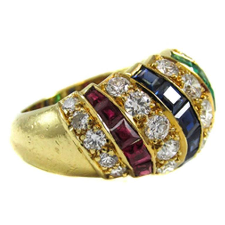 cartier sapphire ruby emerald gold ring for