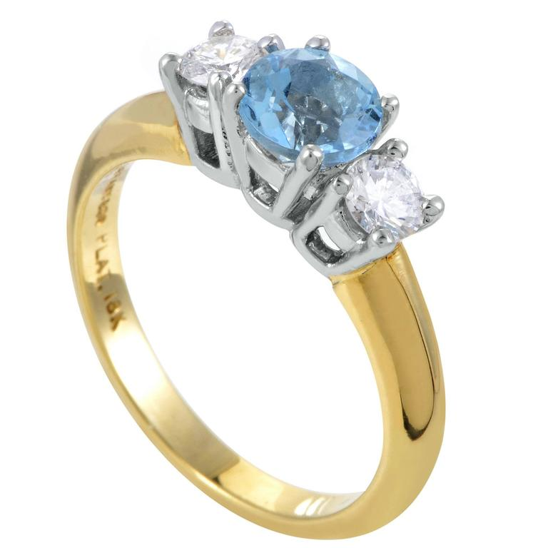 and co yellow gold and platinum gemstone ring at