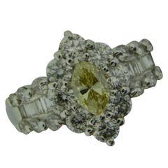 Estate Fancy Light Yellow Diamond and White Diamond Halo Ring