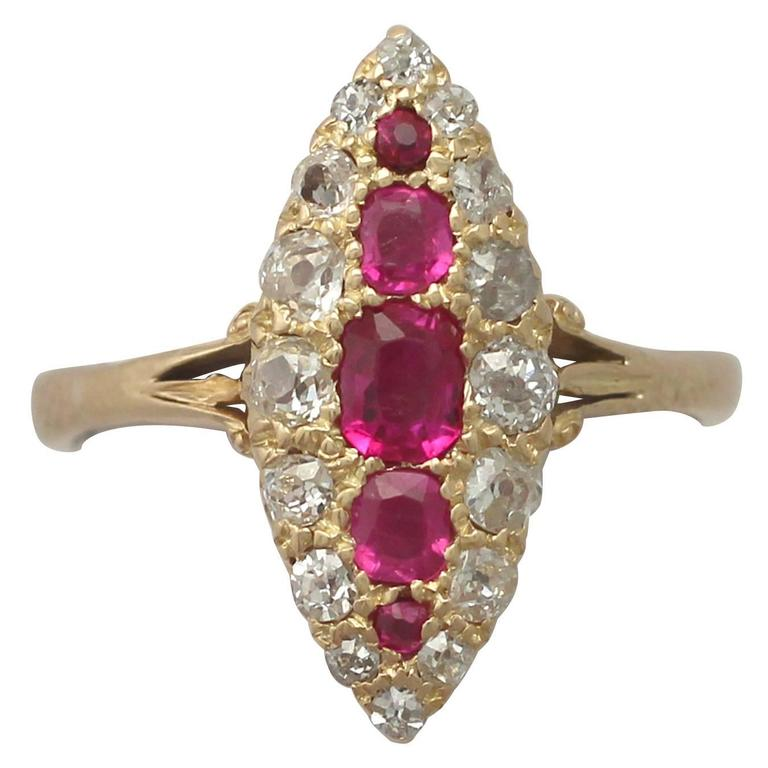 1900s Antique Ruby and Diamond Yellow Gold Marquise Cocktail Ring For Sale
