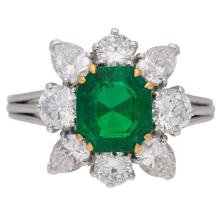 Colombian emerald and diamond cluster ring, English, circa 1970.