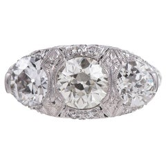 2.60 Carat English Carved Style Art Deco Three Stone Diamond Ring