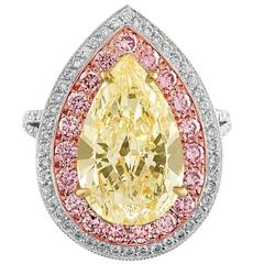 6.92 Carat Pear Shape Light Yellow Ring of Three Colors