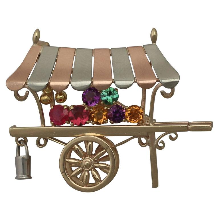 1966 0.85 Ct Multi-Gemstone and 9 k Yellow Gold 'Cart' Brooch