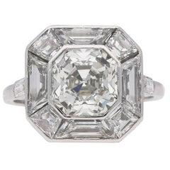 Art Deco Asscher cut diamond cluster ring, English, circa 1930.
