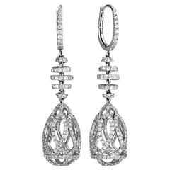 Striking swirl drop diamond earrings