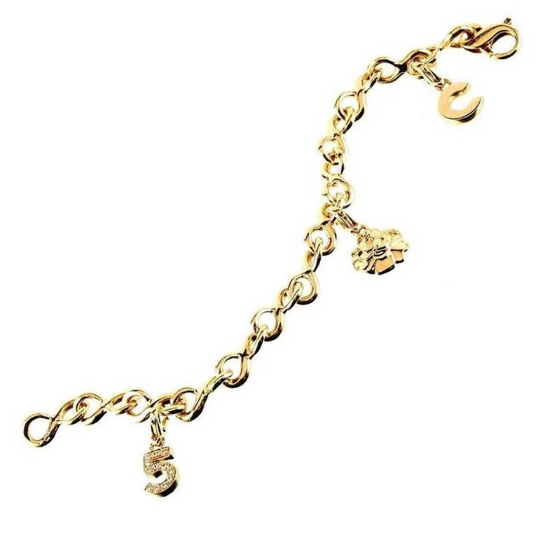 chanel camelia gold charm bracelet for sale at 1stdibs