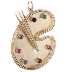 Artist's palette charm with multi-colored gemstones in 14-karat gold