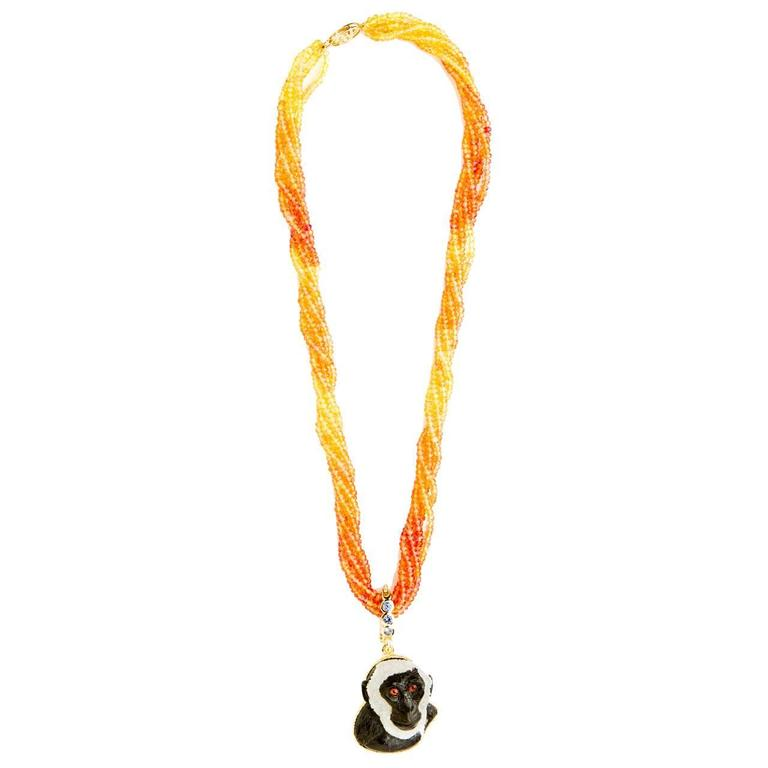Orange and yellow sapphire multistrand necklace with hand-carved monkey pendant