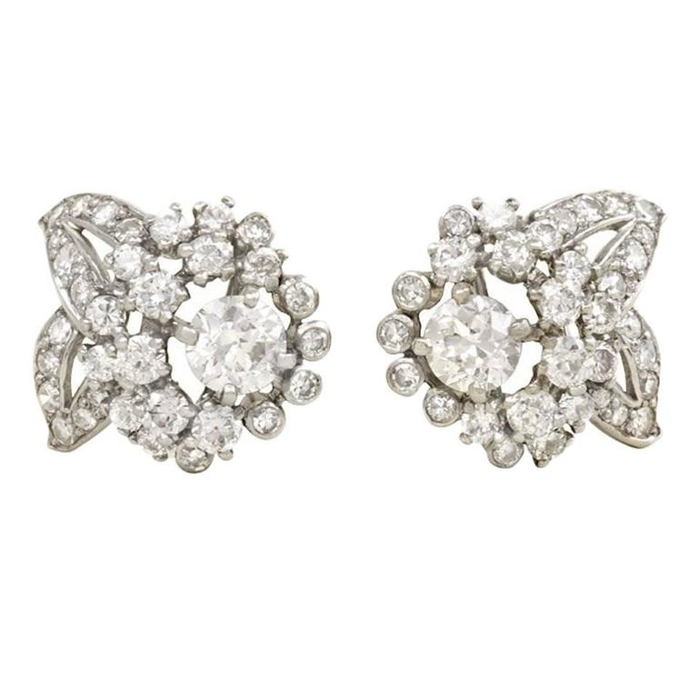 1950s Cartier Diamond Platinum Flower Cer Earrings For