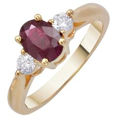1.25 Carat Oval Ruby Round Diamond Yellow Gold Three-Stone Engagement Ring