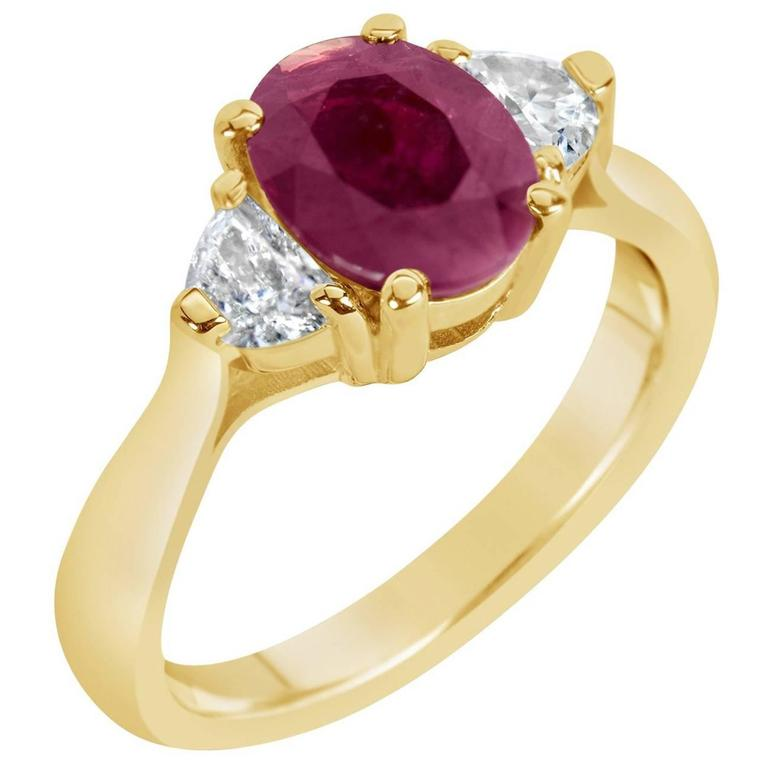 Oval Ruby with Half Moon Diamonds Three-Stone Ring
