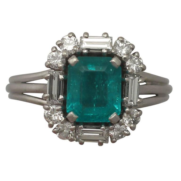 1970s 1.43 Carat Emerald and Diamond Platinum Cocktail Ring