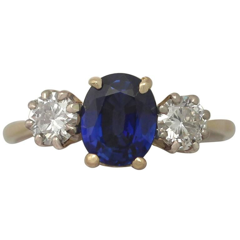 1980s 1.19 Carat Sapphire and Diamond Yellow Gold Trilogy Ring