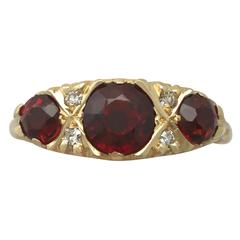 1970s 2.05 Carat Garnet and Diamond Yellow Gold Cocktail Ring