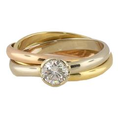 Cartier Tricolor .50 Carat Solitaire Diamond Gold Rolling Engagement Ring