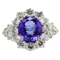 IGI Certified 7.80 Carat Tanzanite Diamonds Gold Ring